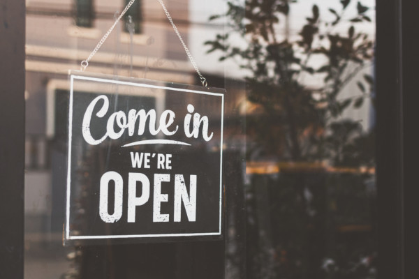 Picture of open sign on business door